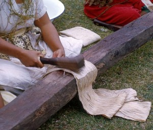 Beating bark to make cloth